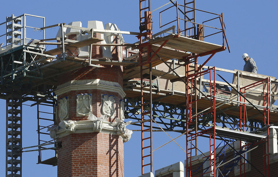 Crews worked last week to repair one of the turrets on the southwest corner of Benedictine Hall at St. Gregory�s University in Shawnee. Damage resulted from the November 2011 earthquake.  PHOTO BY JIM BECKEL, THE OKLAHOMAN