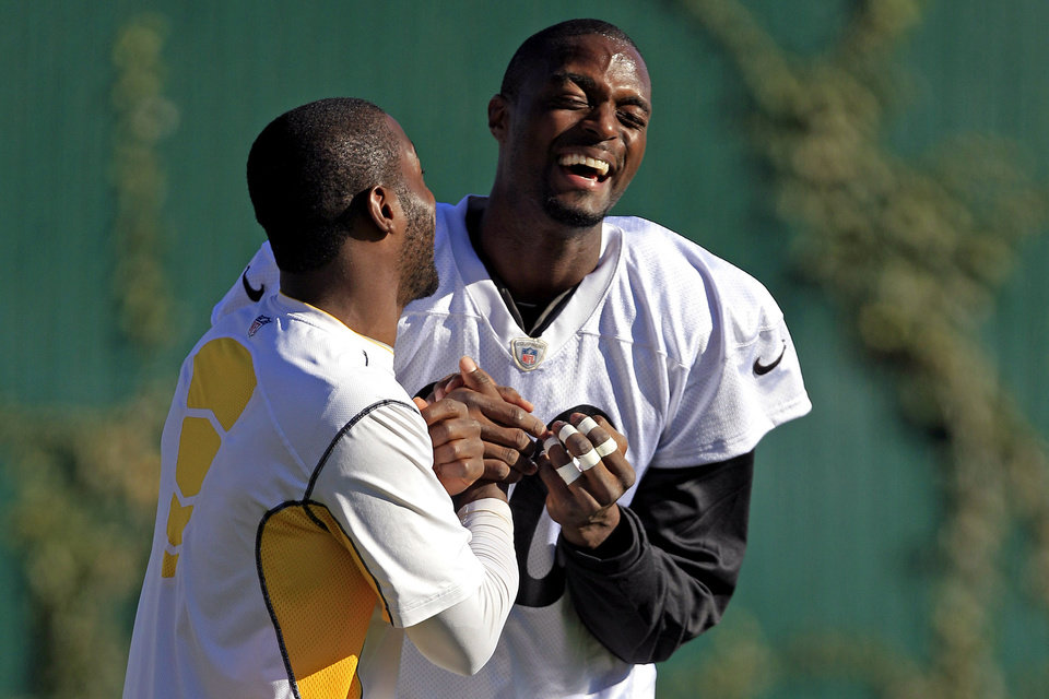 Photo -   Newly signed Pittsburgh Steelers wide receiver Plaxico Burress, right, laughs with injured wide receiver Antonio Brown before NFL football practice, Wednesday, Nov. 21, 2012, in Pittsburgh. Burress returned to the team that drafted him a dozen years ago on Wednesday hungry, humble and eager to prove there's still some life left in a career that's never quite lived up to his own outsized expectations. (AP Photo/Gene J. Puskar)