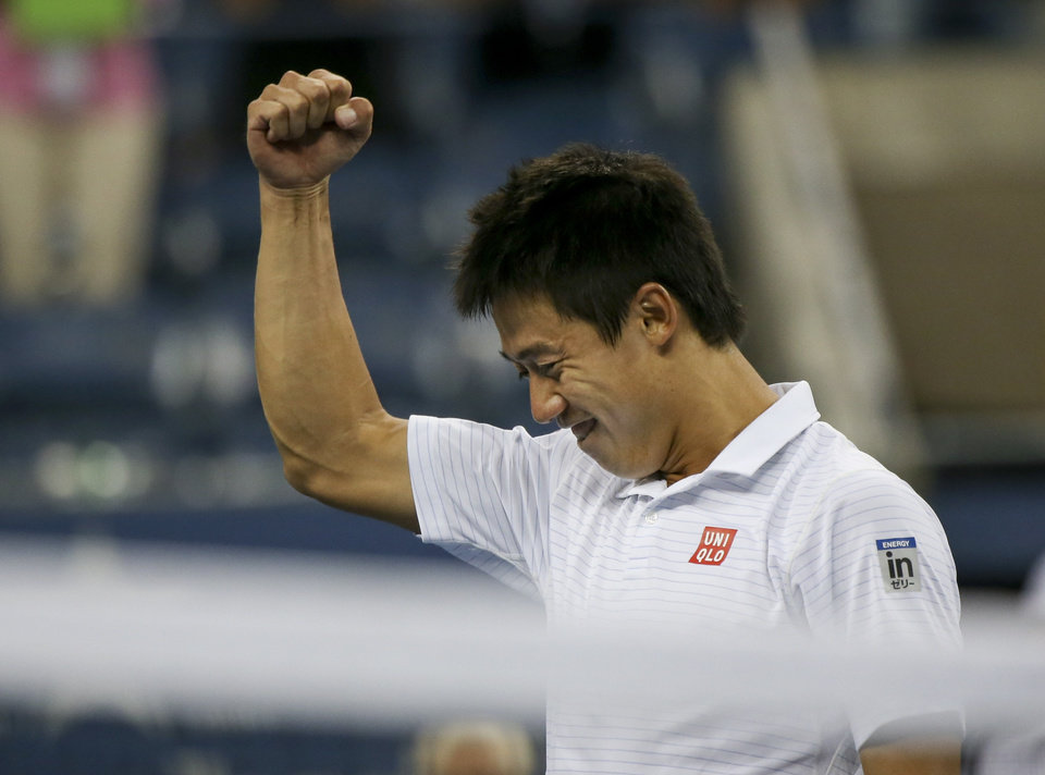 Photo - Kei Nishikori, of Japan, reacts after defeating Stan Wawrinka, of Switzerland, in five sets during the quarterfinals of the 2014 U.S. Open tennis tournament, Wednesday, Sept. 3, 2014, in New York. (AP Photo/Mike Groll)