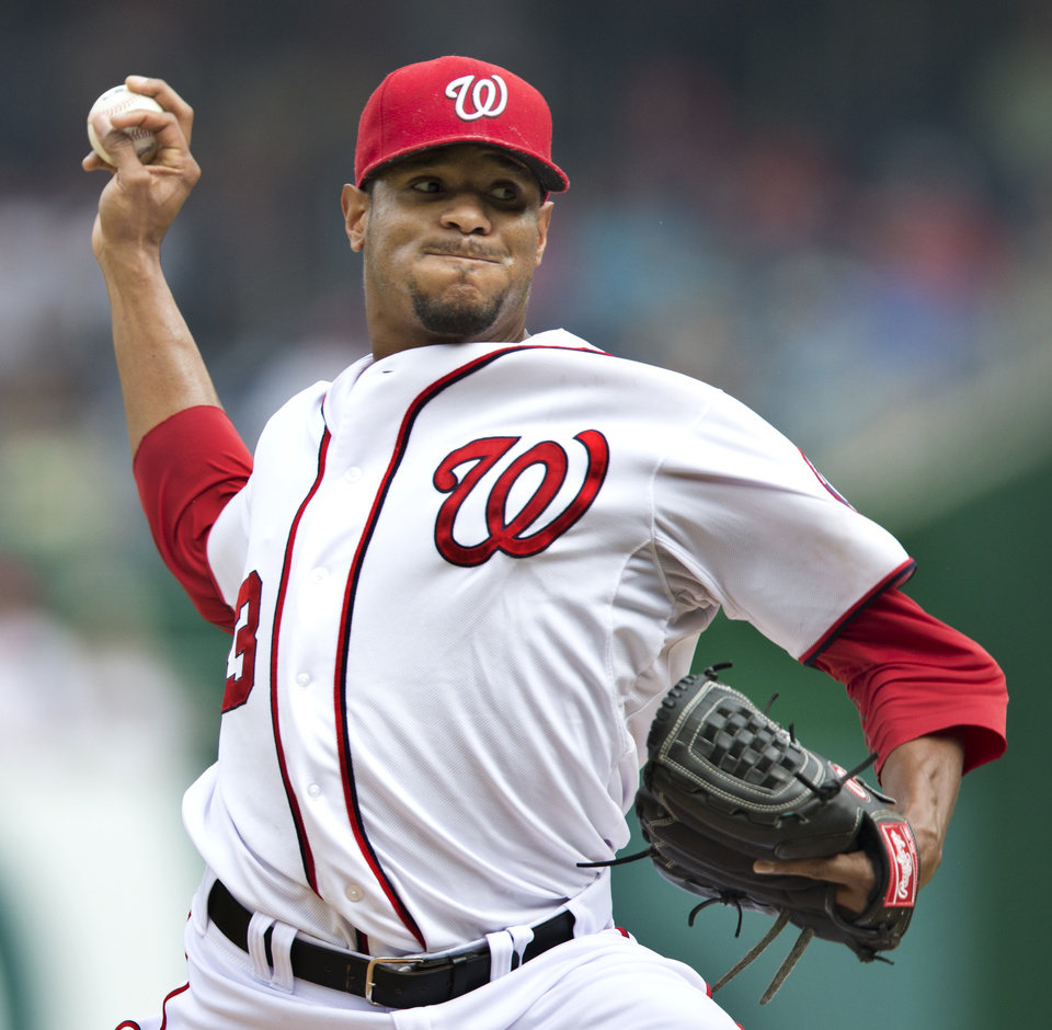 Washington Nationals starter Edwin Jackson throws a pitch during the second inning of a baseball game against the Philadelphia Phillies in Washington, Wednesday, Oct. 3, 2012. (AP Photo/Manuel Balce Ceneta)
