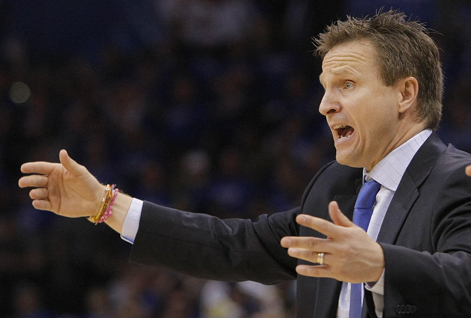 Photo - Thunder coach Scott Brooks reacts to a call during the first round NBA playoff game between the Oklahoma City Thunder and the Denver Nuggets on Sunday, April 17, 2011, in Oklahoma City, Okla. Photo by Chris Landsberger, The Oklahoman