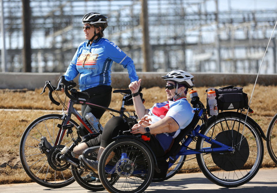 Photo - After a ceremony marking the completion of MAPS 3 Will Rogers Trail, cyclists rode the trail east of May between I-40 and the Oklahoma River. [PHOTO BY JIM BECKEL, THE OKLAHOMAN]