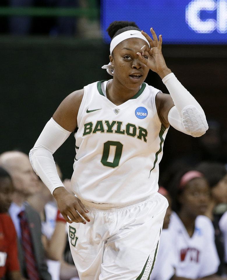 Photo - Baylor guard Odyssey Sims (0) celebrates scoring a 3-point basket in the first half of a first-round game in the NCAA women's college basketball tournament against Western Kentucky, Saturday, March 22, 2014, in Waco, Texas. (AP Photo/Tony Gutierrez)
