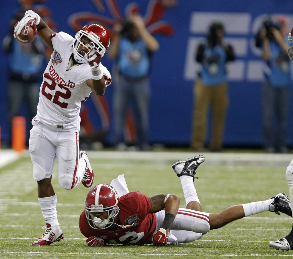 Photo - Oklahoma's Roy Finch (22) gets past Alabama's Deion Belue (13) during the NCAA football BCS Sugar Bowl game between the University of Oklahoma Sooners (OU) and the University of Alabama Crimson Tide (UA) at the Superdome in New Orleans, La., Thursday, Jan. 2, 2014.  .Photo by Chris Landsberger, The Oklahoman
