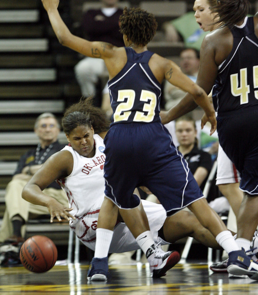 Photo - Courtney Paris hits the floor after being fouled on a defensive rebound in the second half as the University of Oklahoma (OU) plays Georgia Tech in round two of the 2009 NCAA Division I Women's Basketball Tournament at Carver-Hawkeye Arena at the University of Iowa in Iowa City, IA on Tuesday, March 24, 2009. 