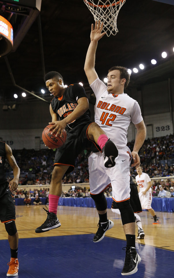 Douglass\' Trevon Threatt gets a rebound in front of Austin Cantrell during the 4a boys championship game where the Douglass high school Trojans play the Roland Rangers at the State Fair Arena on Saturday, March 9, 2013 in Oklahoma City, Okla. Photo by Steve Sisney, The Oklahoman