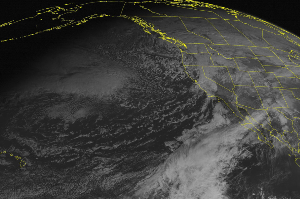 This NOAA satellite image taken Saturday, Dec. 22, 2012 at 2:00 p.m. EST shows a cold front moving into northern California and the Pacific Northwest with coastal rain and mountain snow. Cloudy conditions are seen over the central and southern Rocky Mountains. (AP Photo/Weather Underground)