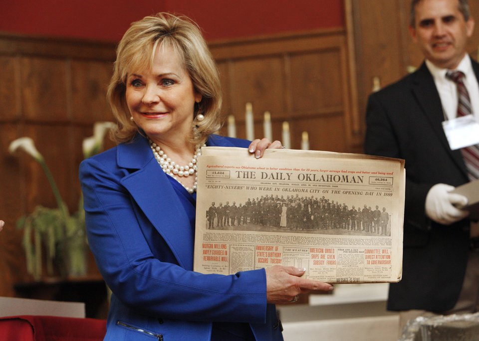 Gov. Mary Fallin holds up a Sunday, April 20, 1913, newspaper just removed from the Century Chest at First Lutheran Church in Oklahoma City Monday, April 22, 2013. The Century Chest is a time capsule put together and buried April 22, 1913 by the church. Photo by Paul B. Southerland, The Oklahoman