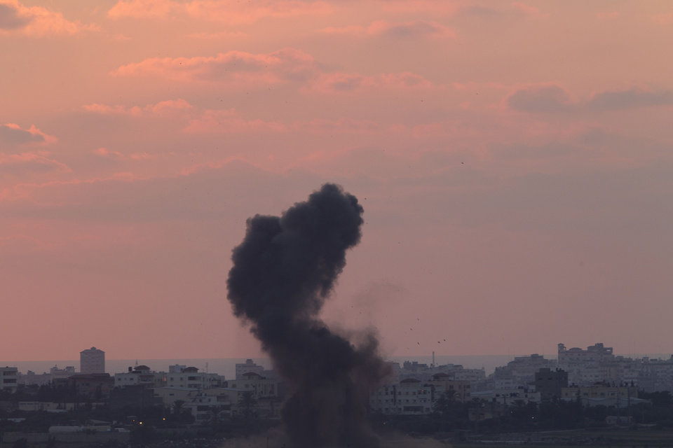 Photo - Smoke rises after an Israeli missile strike in the Gaza strip as seen from the Israel Gaza border on Wednesday, July 16, 2014. Israeli war planes and naval vessels intensified attacks across the Gaza Strip on Wednesday, targeting senior Hamas leaders and bombarding a coastal area. (AP Photo/Ariel Schalit)