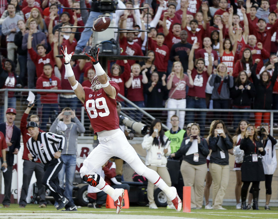 Photo - Stanford wide receiver Devon Cajuste (89) catches a touchdown pass against Notre Dame during the first half of an NCAA college football game on Saturday, Nov. 30, 2013, in Stanford, Calif. (AP Photo/Marcio Jose Sanchez)