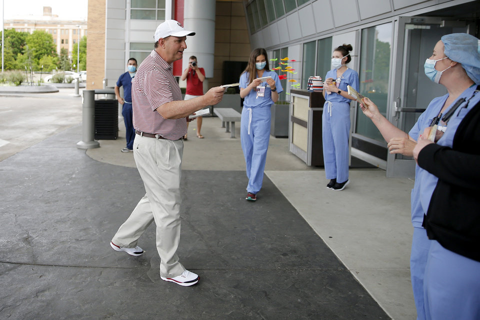 Photo - University of Oklahoma Director of Athletics Joe Castiglione greets medical staff outside OU Children's Hospital as he and other members of the OU Athletics Department  and family participated in a caravan around the OU Medical Center campus to show their gratitude and appreciation for frontline healthcare workers in their fight against COVID-19 in Oklahoma City, Sunday, May 3, 2020. [Bryan Terry/The Oklahoman]