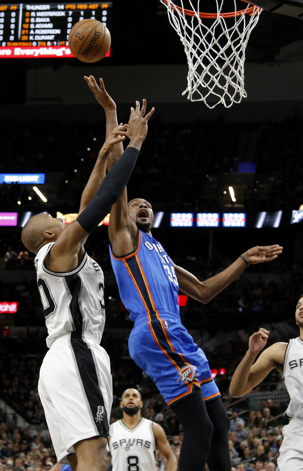 Photo - Oklahoma City's Kevin Durant (35) is fouled by San Antonio's David West (30) during Game 2 of the second-round series between the Oklahoma City Thunder and the San Antonio Spurs in the NBA playoffs at the AT&T Center in San Antonio, Monday, May 2, 2016. Photo by Bryan Terry, The Oklahoman