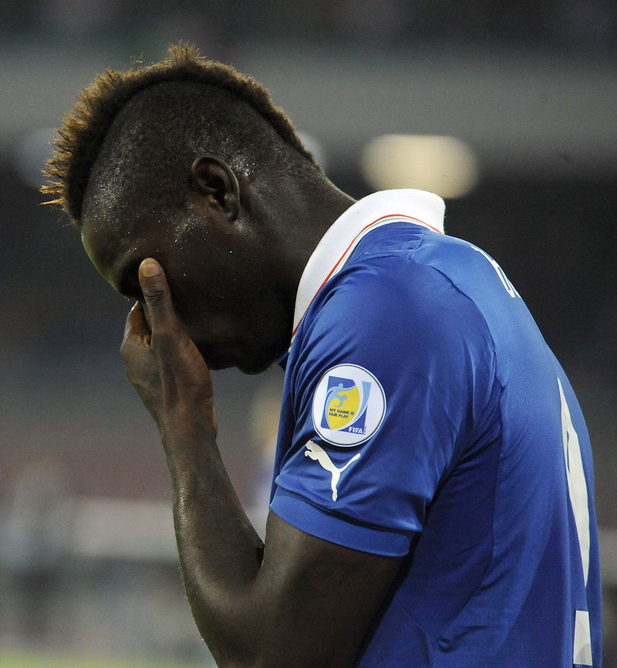 Photo - Italy's Mario Balotelli looks down during a World Cup, Group B, qualification match between Italy and Armenia in Naples, Italy, Tuesday, Oct. 15, 2013. The game ended in a 2-2 draw. (AP Photo/Salvatore Laporta)