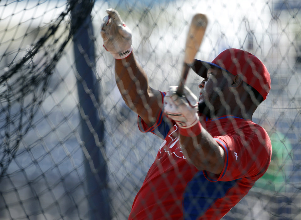 Photo - Philadelphia Phillies right fielder Leandro Castro takes batting practice before an exhibition baseball game against the Tampa Bay Rays, Monday, March 3, 2014, in Port Charlotte, Fla. (AP Photo/Steven Senne)
