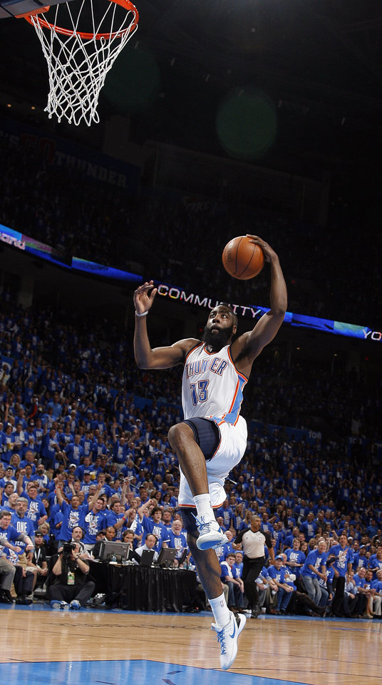 Oklahoma City's James Harden (13) goes up for a dunk during Game 1 in the second round of the NBA playoffs between the Oklahoma City Thunder and the L.A. Lakers at Chesapeake Energy Arena in Oklahoma City, Monday, May 14, 2012. Photo by Sarah Phipps, The Oklahoman