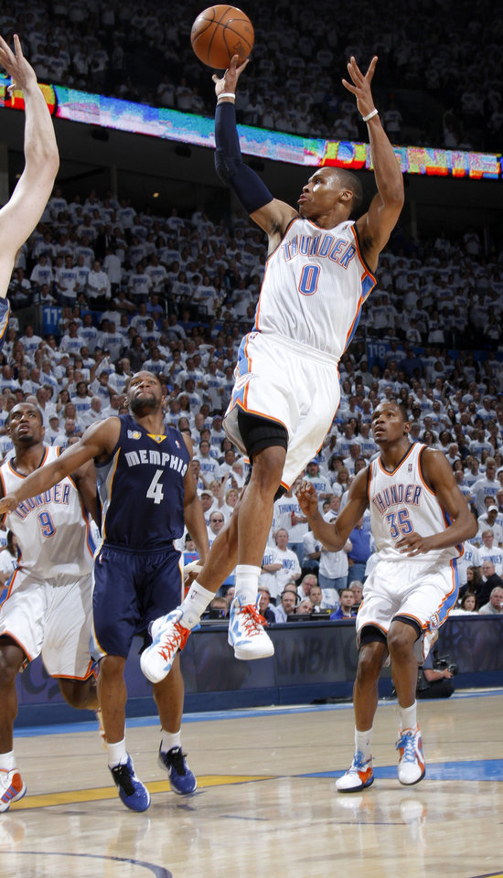 Photo - Oklahoma City's Russell Westbrook (0) passes the ball during game five of the Western Conference semifinals between the Memphis Grizzlies and the Oklahoma City Thunder in the NBA basketball playoffs at Oklahoma City Arena in Oklahoma City, Wednesday, May 11, 2011. Photo by Bryan Terry, The Oklahoman
