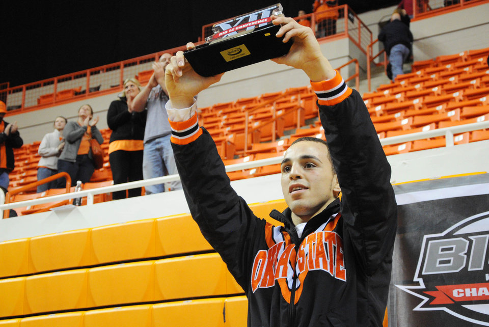 Photo - Oklahoma State wrestler Jordan Oliver was named the outstanding wrestler of the Big 12 tournament after winning his 149 pound weight class on March 9, 2013. KT King/For the Tulsa World