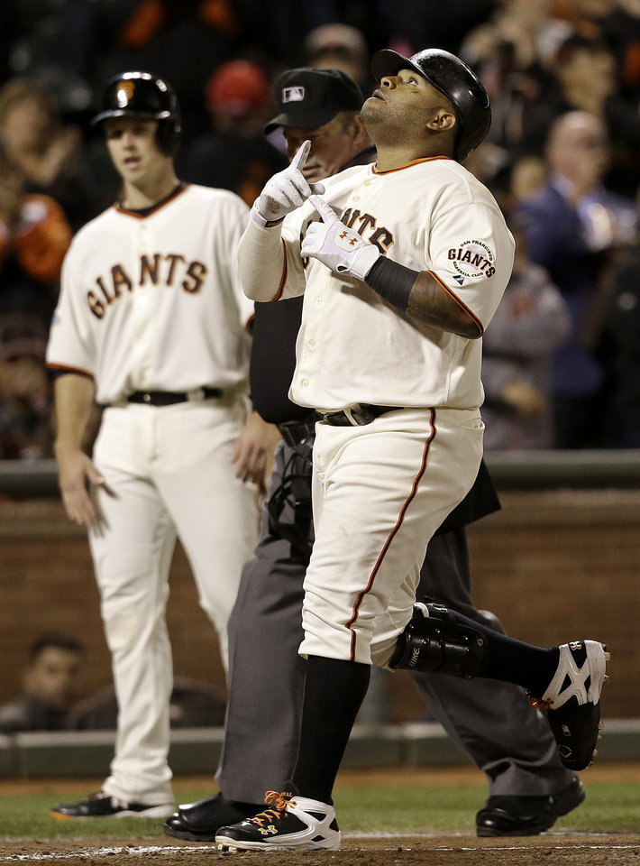 Photo - San Francisco Giants' Pablo Sandoval celebrates after hitting a two-run home run that scored Buster Posey, rear, off of Los Angeles Dodgers pitcher Ricky Nolasco during the fourth inning of a baseball game in San Francisco, Wednesday, Sept. 25, 2013. (AP Photo/Jeff Chiu)