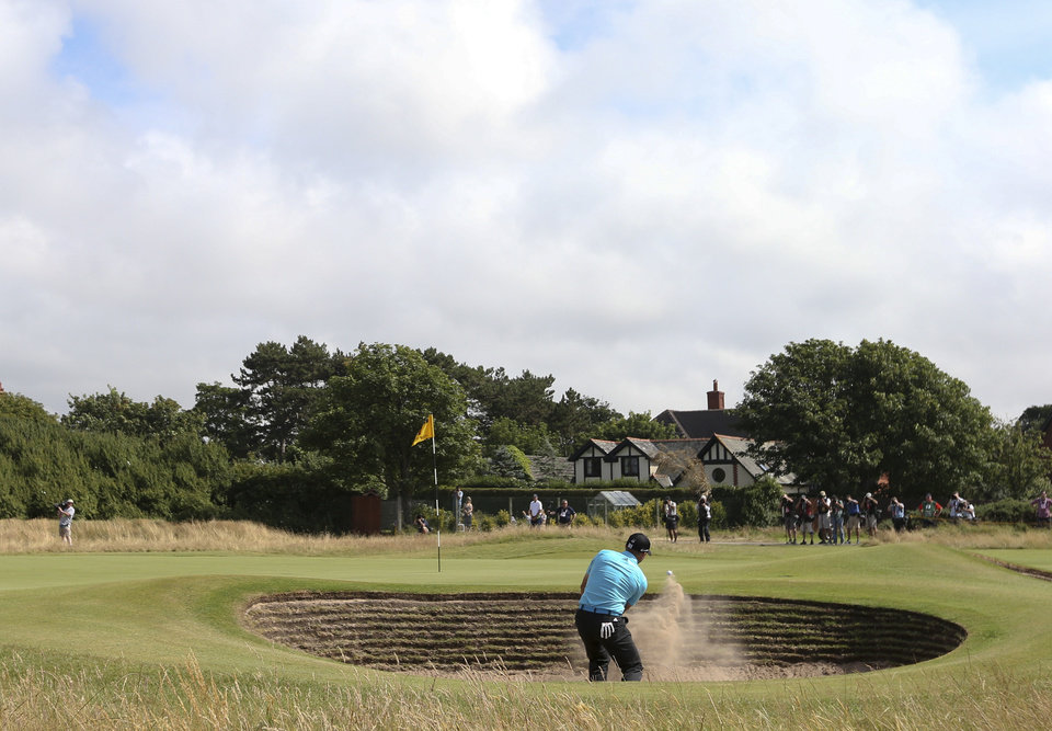 Photo - Sergio Garcia of Spain plays out of the bunker onto the 7th green during the final round of the British Open Golf championship at the Royal Liverpool golf club, Hoylake, England, Sunday July 20, 2014. (AP Photo/Scott Heppell)