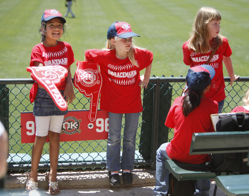 Photo - OKLAHOMA CITY REDHAWKS / MINOR LEAGUE BASEBALL / KIDS DAY / CHILD / CHILDREN: Duncan's Horace Mann Elementary school students Brianna Guerva, left, Zoey Smith and Emma Baugh enjoy the atmosphere during the RedHawks' game against the Salt Lake Bees at the Chickasaw Bricktown Ballpark in Oklahoma City, OK, Tuesday, May 14, 2013,  By Paul Hellstern, The Oklahoman