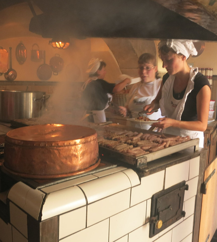 Photo -  The kitchen at the historic Wurstkuche, the 12th-century brat house in Regensburg, Germany, turns out their famous fare for visitors from around the globe. Photo courtesy of Jerry Farlow.