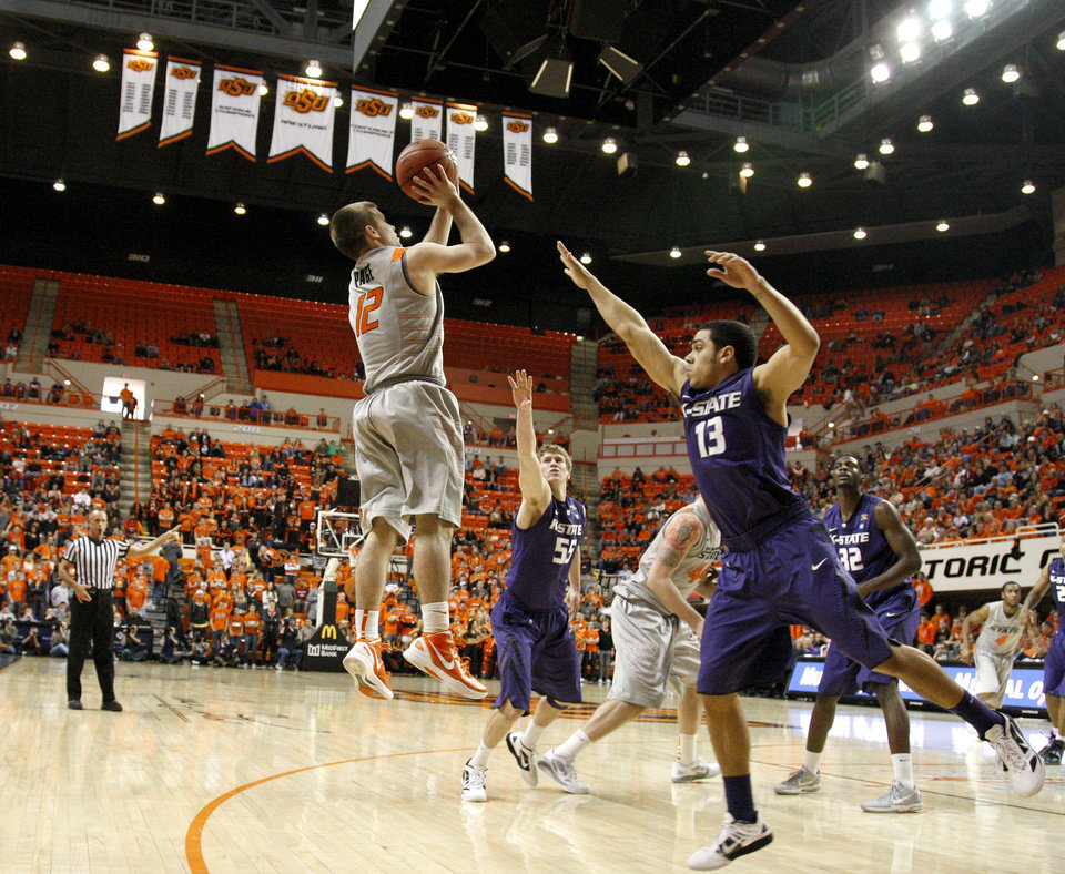 Photo - Oklahoma State's Keiton Page (12) shoots the ball between Kansas State's Angel Rodriguez (13) and Will Spradling (55) during an NCAA college basketball game between the Oklahoma State University Cowboys (OSU) and the Kansas State University Wildcats (KSU) at Gallagher-Iba Arena in Stillwater, Okla., Saturday, Jan. 21, 2012. Photo by Bryan Terry, The Oklahoman