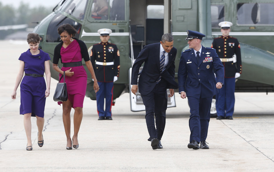 President Barack Obama and first lady Michelle Obama are accompanied by Air Force Col. William Knight and his wife Susan as they walk from the Marine One helicopter  to board Air Force One at Andrews Air Force Base, Md., Wednesday, April 24, 2013, as they travel to Dallas to attend the George W. Bush presidential library dedication and the memorial for victims of the fertilizer plant explosion in West, Texas. (AP Photo/Charles Dharapak)