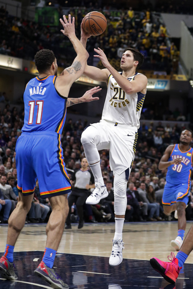 Photo - Indiana Pacers forward Doug McDermott (20) shoots over Oklahoma City Thunder forward Abdel Nader (11) during the second half of an NBA basketball game in Indianapolis, Tuesday, Nov. 12, 2019. The Pacers won 111-85. (AP Photo/Michael Conroy)