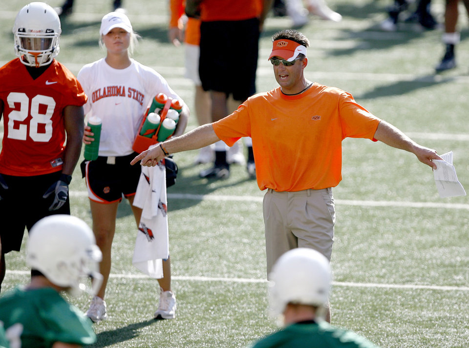 Photo - Oklahoma State coach Mike Gundy gives instructions at the Cowboys' first practice on Wednesday at Boone Pickens Stadium in Stillwater. (Photo by Bryan Terry, The Oklahoman)