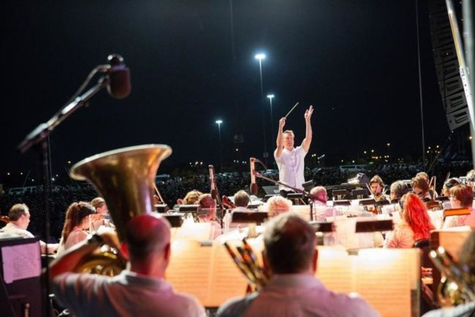 Photo -  Maestro Alexander Mickelthwate conducts the Oklahoma City Philharmonic in concert. The orchestra will perform the finale of the three-day Scissortail Park Grand Opening Weekend. [Photo provided]