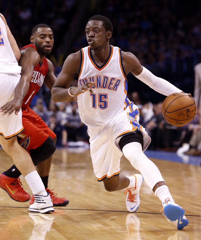 Photo - Thunder's Reggie Jackson (15) drives during the second half of an NBA basketball game between the Oklahoma City Thunder and the New Orleans Pelicans at Chesapeake Energy Arena on Dec. 21, 2014 in Oklahoma City, Okla. Photo by Steve Sisney, The Oklahoman