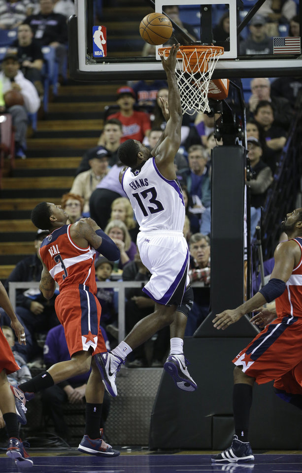 Sacramento Kings  guard Tyreke Evans, right, drives to the basket against Washington Wizards forward Trevor Ariza, left, during the first quarter of an NBA basketball game in Sacramento, Calif., Wednesday, Jan. 16, 2013. (AP Photo/Rich Pedroncelli)