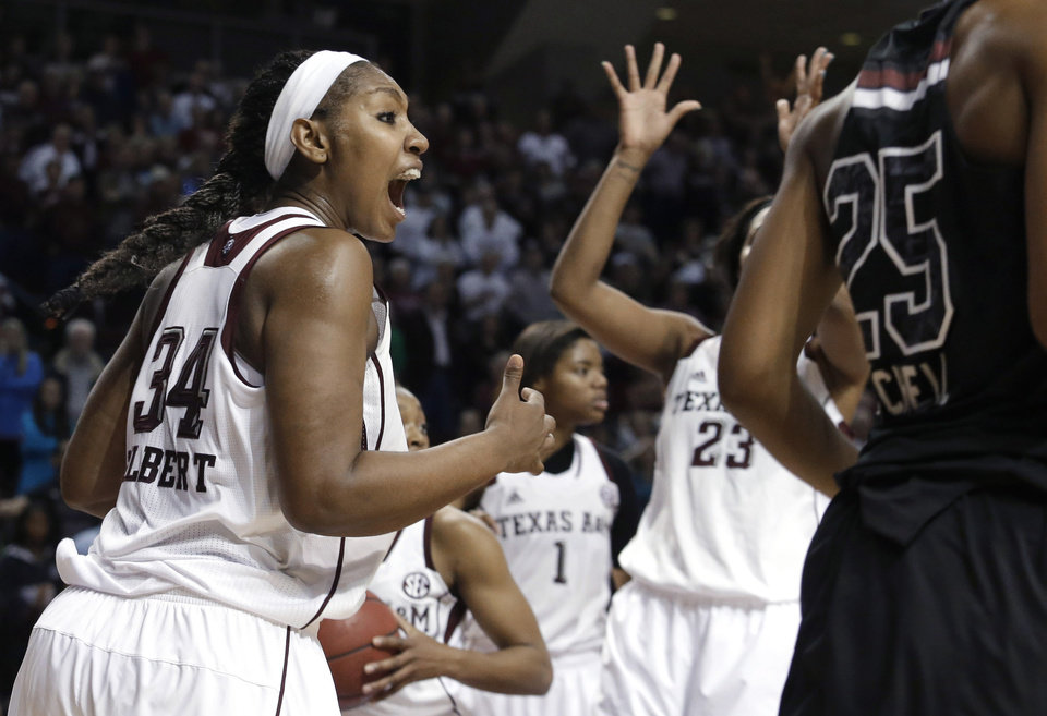 Photo - Texas A&M center Karla Gilbert (34) celebrates during the second half of an NCAA college basketball game against South Carolina, Thursday, Jan. 16, 2014, in College Station, Texas. Texas A&M defeated South Carolina 67-65 in overtime. (AP Photo/Patric Schneider)