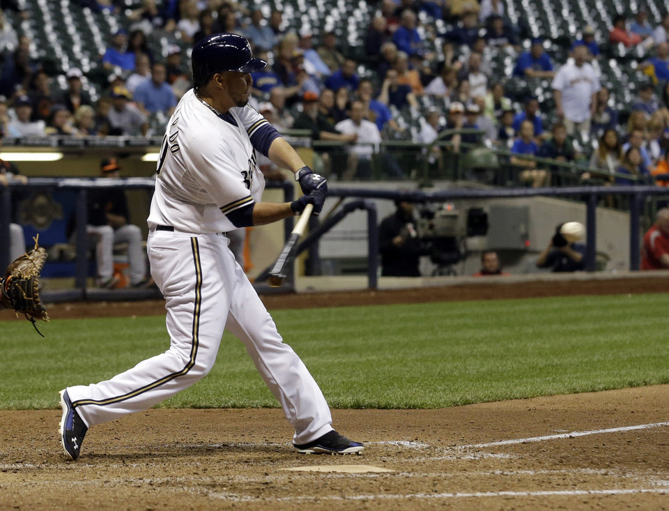 Photo - Milwaukee Brewers' Yovani Gallardo hits a game-winning double during the 10th inning of a baseball game against the Baltimore Orioles Tuesday, May 27, 2014, in Milwaukee. The Brewers won 7-6. (AP Photo/Morry Gash)