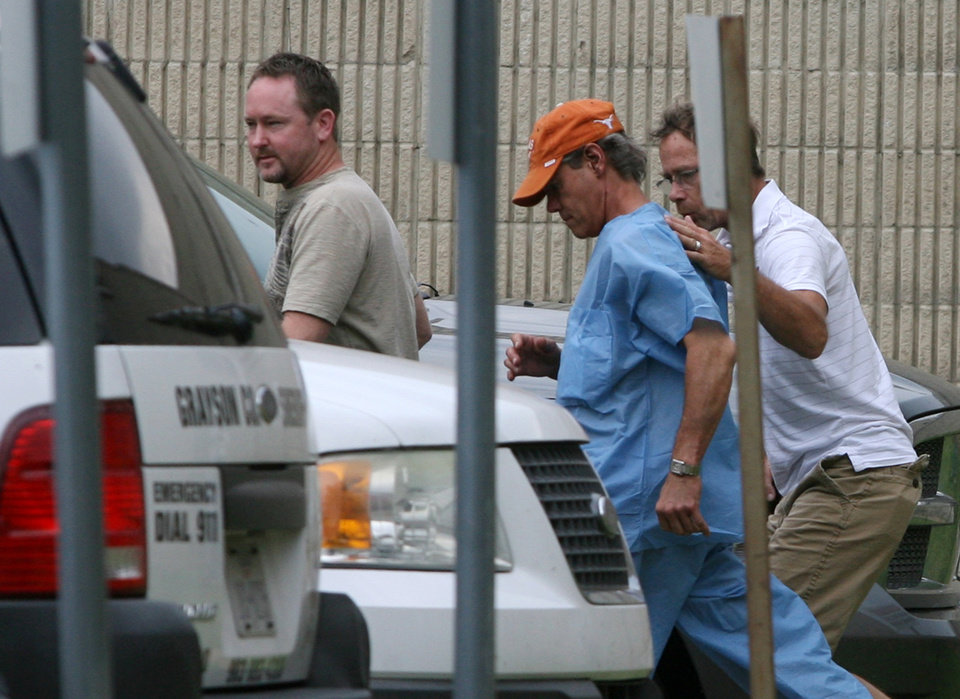 Photo -   Randy Travis, center wearing cap, exits the Grayson County jail with two unknown persons Wednesday Aug. 8, 2012, in Sherman, Texas, after being arraigned on charges of driving while intoxicated and retaliation. (AP Photo/The Herald Democrat, Chris Jennings) TV OUT; MAGS OUT; TV AND MAGAZINE CALL FOR RATES TERMS;MANDATORY CREDIT