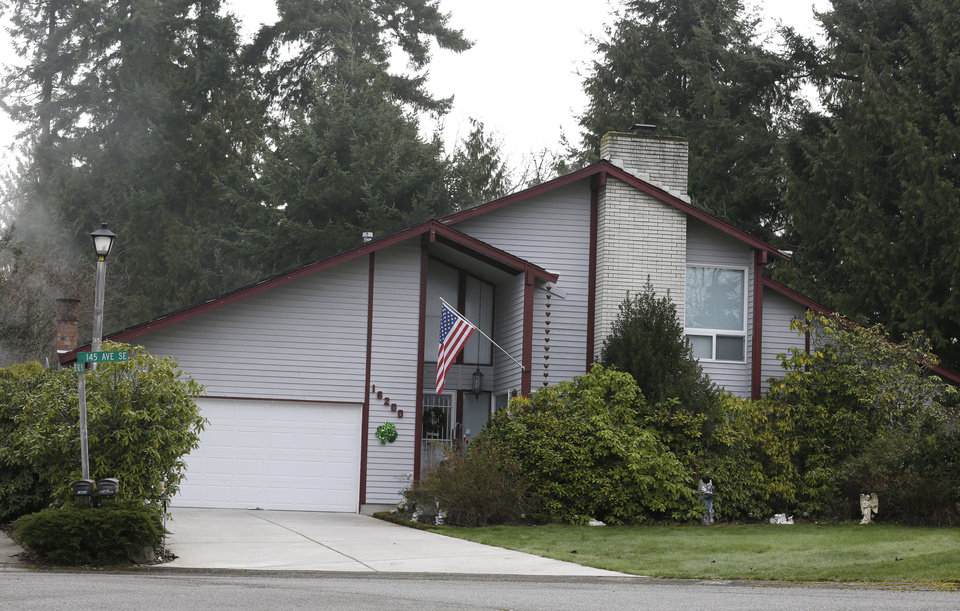 Photo - The house where the bodies of an elderly couple were found Saturday, March 9, 2013, is shown Monday, March 11, 2013, in Renton, Wash. Washington state authorities are looking for Michael