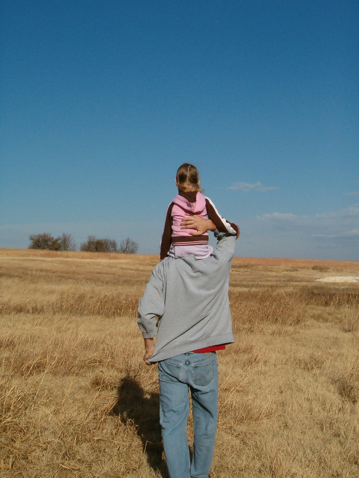THIS WAS TAKEN AT MY GRANDMAS FARM UP IN THE PASTURE.  IT IS OF MY HUSBAND, ROBERT AND OUR OLDEST GIRL IRELAND<br/><b>Community Photo By:</b> BETHANY BROCK<br/><b>Submitted By:</b> ROBERT, BETHANY