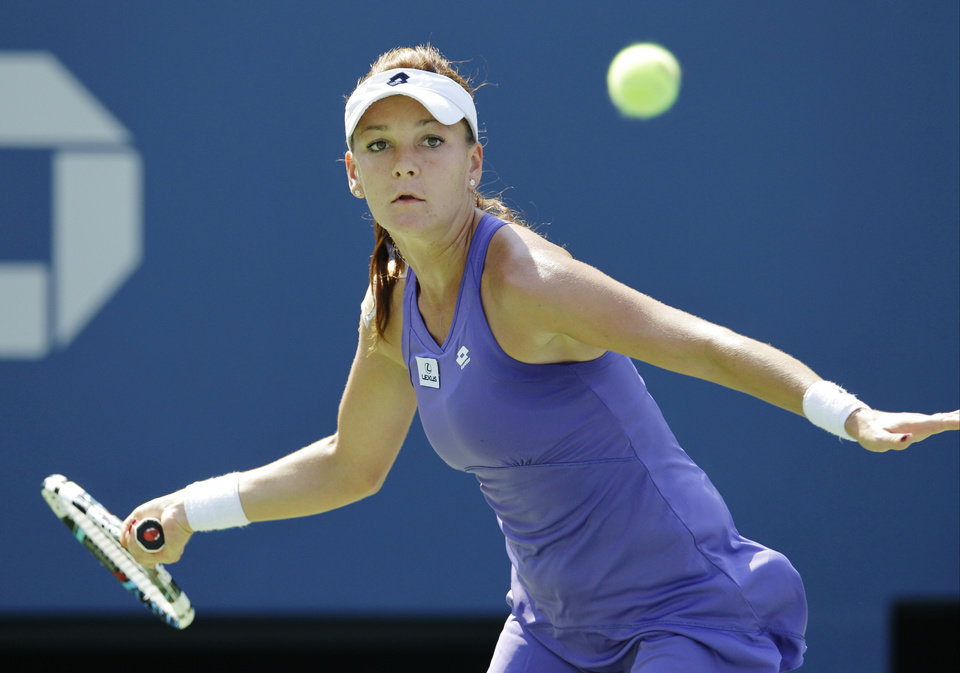 Photo -   Agnieszka Radwanska, of Poland, returns a shot to Serbia's Jelena Jankovicin the third round of play at the 2012 US Open tennis tournament, Saturday, Sept. 1, 2012, in New York. (AP Photo/Kathy Willens)