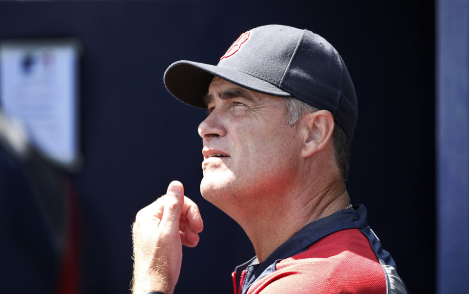 Photo - Boston Red Sox manager John Farrell talks to another coach from the dugout during a spring exhibition baseball game against the New York Yankees in Tampa, Fla., Tuesday, March 18, 2014.  The Yankees defeated the Red Sox 8-1.  (AP Photo/Kathy Willens)