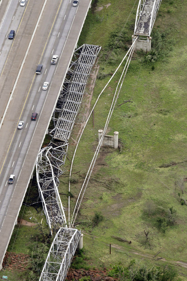 Photo - This aerial photo shows tornado damage to the old U.S. 62 bridge over the Canadian River near Newcastle. The bridge, which runs parallel to Interstate 44, has been closed to traffic since 1963. AP PHOTO BY TONY GUTIERREZ  Tony Gutierrez