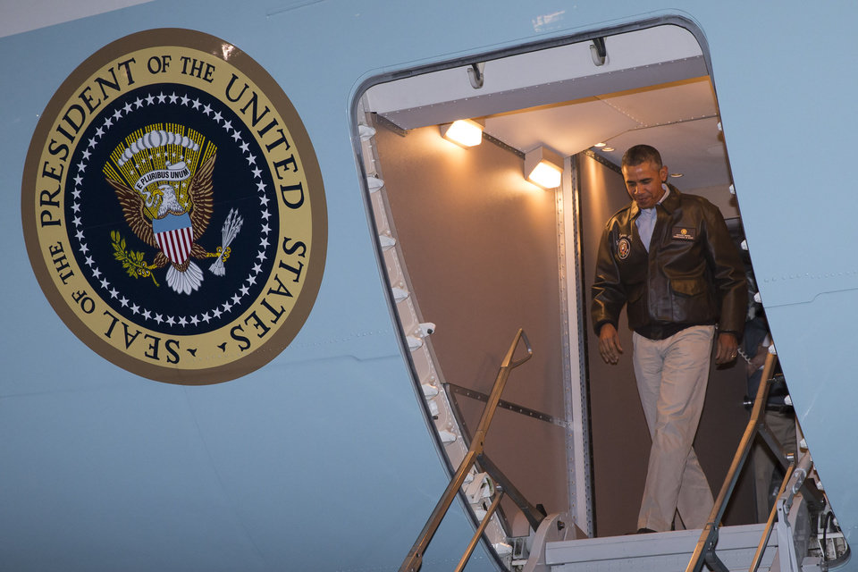 Photo - President Barack Obama steps off Air Force One after arriving at Bagram Air Field for an unannounced visit, on Sunday, May 25, 2014, north of Kabul, Afghanistan. (AP Photo/ Evan Vucci)