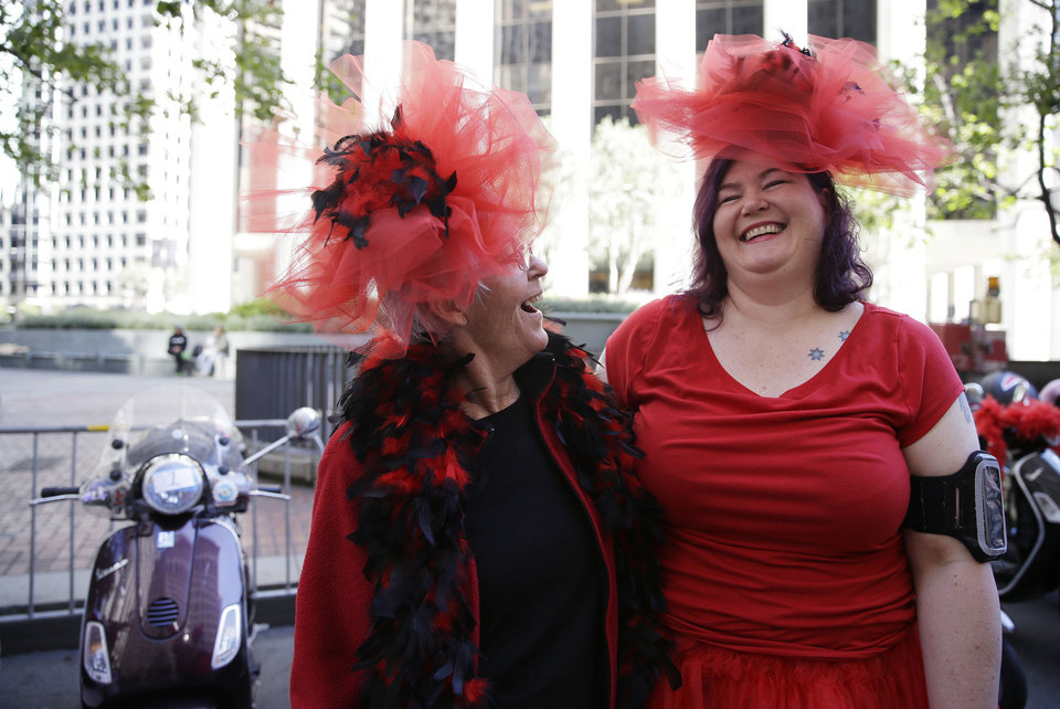 Photo - Kay Quinn, left, of Redmond, Ore., laughs with her daughter Joanne Owens, right, of San Leandro, Calif., while waiting for the start of the 44th annual San Francisco Gay Pride parade Sunday, June 29, 2014, in San Francisco. The lesbian, gay, bisexual, and transgender celebration and parade is one of the largest LGBT gatherings in the nation. The pair were riding in the parade with a group called the San Francisco Scooter Girls. (AP Photo/Eric Risberg)