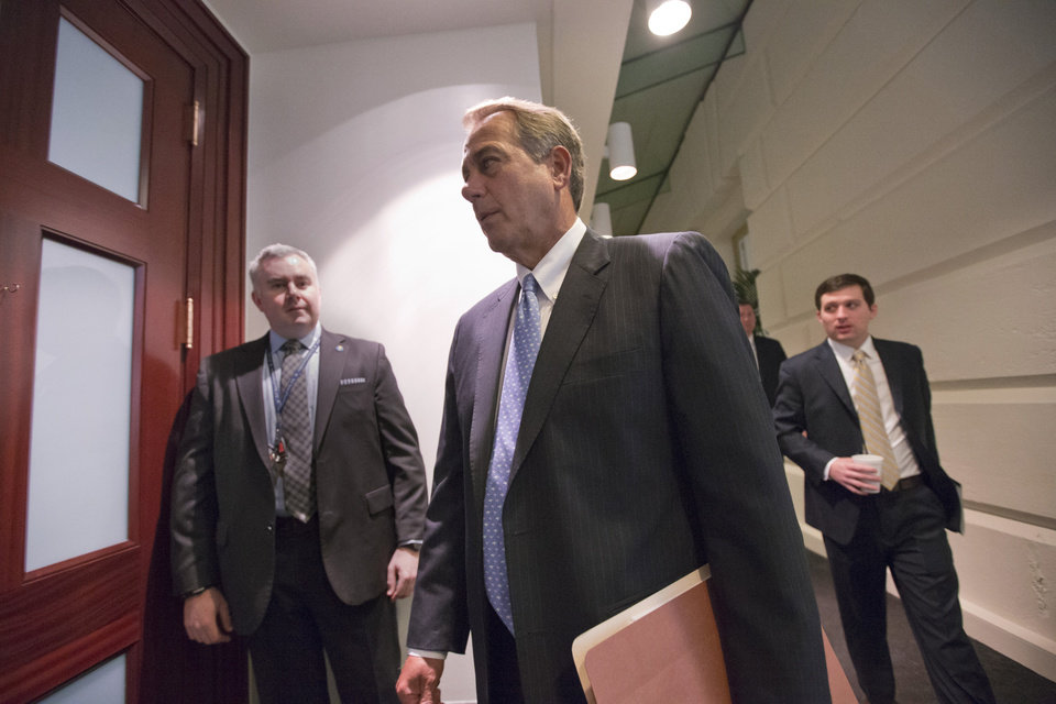 Photo - House Speaker John Boehner of Ohio arrives for a closed-door meeting with House Republicans, Tuesday, Feb. 5, 2013, on Capitol Hill in Washington. (AP Photo/J. Scott Applewhite)