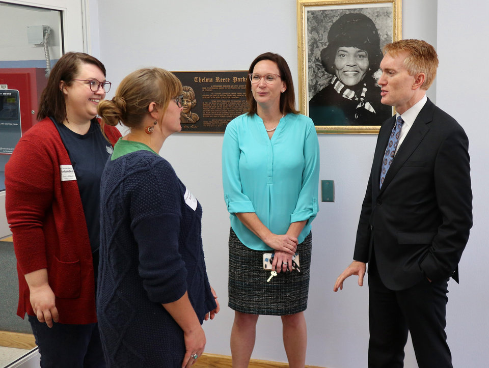 Photo - Sen. James Lankford talks with, from left, Sara Hawk, Ann Miller and Principal Michelle Lewis  after taking a tour of Thelma Parks Elementary School in Oklahoma City looking at the RESTORE OKC program there Tuesday, October 8, 2019. [Doug Hoke/The Oklahoman]