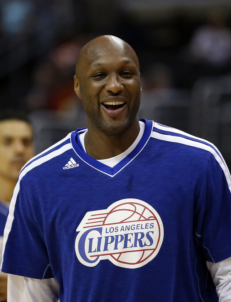 Photo - FILE - In this March 13, 2013, file photo, Los Angeles Clippers' Lamar Odom smiles during NBA basketball practice in Los Angeles. Odom was arrested for allegedly driving under the influence early Friday, Aug. 30, 2013, after a CHP officer saw his white Mercedes-Benz traveling erratically on a San Fernando Valley freeway. The CHP says Odom, 33, was arrested after failing a field sobriety test. (AP Photo/Jae C. Hong, File)