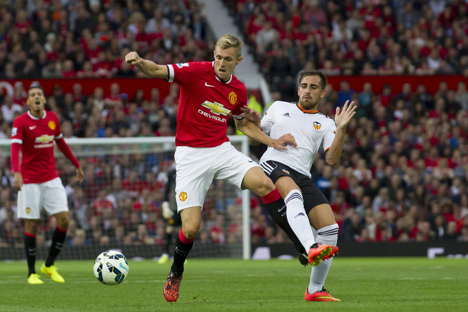 Photo - Manchester United's Darren Fletcher, left, in action against Valencia's Paco Alcacer during a pre season friendly soccer match at Old Trafford Stadium, Manchester, England, Tuesday Aug. 12, 2014. (AP Photo/Jon Super)