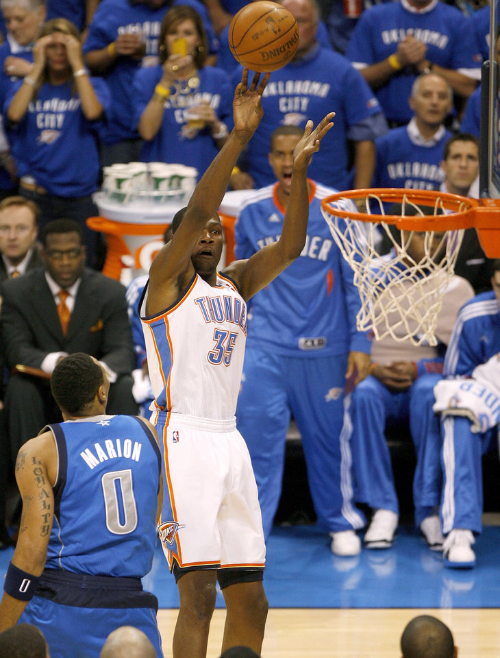 Photo - Oklahoma City's Kevin Durant (35) shoots the ball during game 4 of the Western Conference Finals in the NBA basketball playoffs between the Dallas Mavericks and the Oklahoma City Thunder at the Oklahoma City Arena in downtown Oklahoma City, Monday, May 23, 2011. Photo by Bryan Terry, The Oklahoman