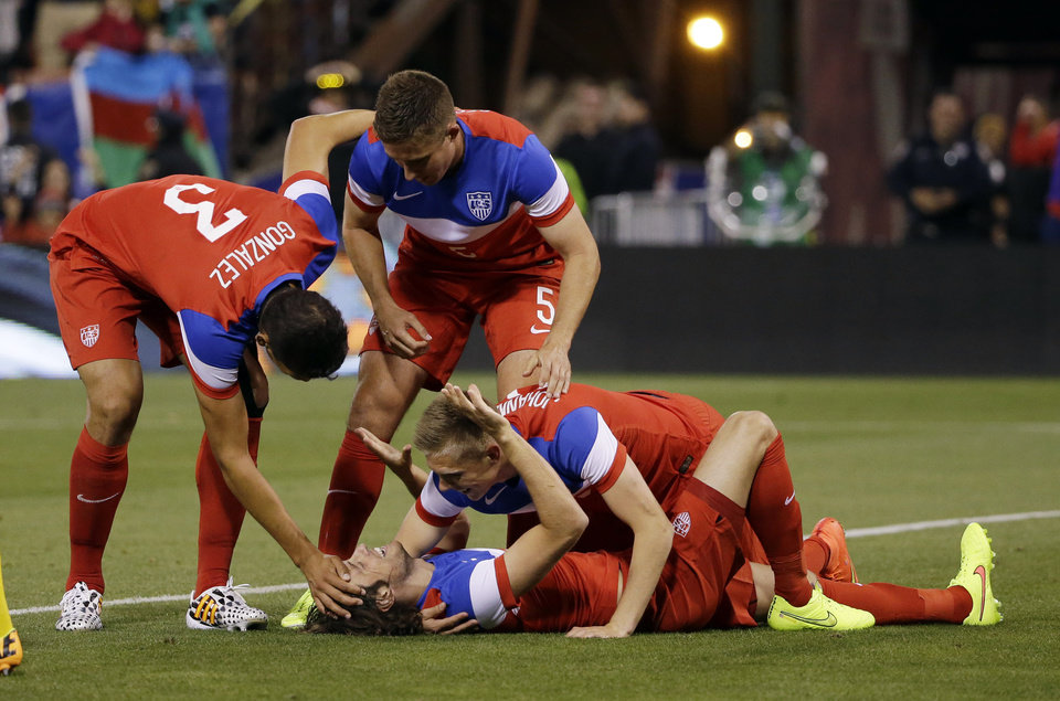 Photo - United States' Mix Diskerud, bottom, celebrates his goal with teammates during the second half of an international friendly soccer match against Azerbaijan on Tuesday, May 27, 2014, in San Francisco. United States won 2-0. (AP Photo/Marcio Jose Sanchez)