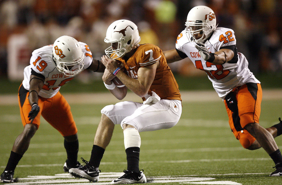 Photo - Oklahoma State's Brodrick Brown (19) and Oklahoma State's Justin Gent (42) tackle Texas' Garrett Gilbert (7)during the college football game between the Oklahoma State University Cowboys (OSU) and the University of Texas Longhorns (UT) at Darrell K Royal-Texas Memorial Stadium in Austin, Texas, Saturday, November 13, 2010. Photo by Sarah Phipps, The Oklahoman