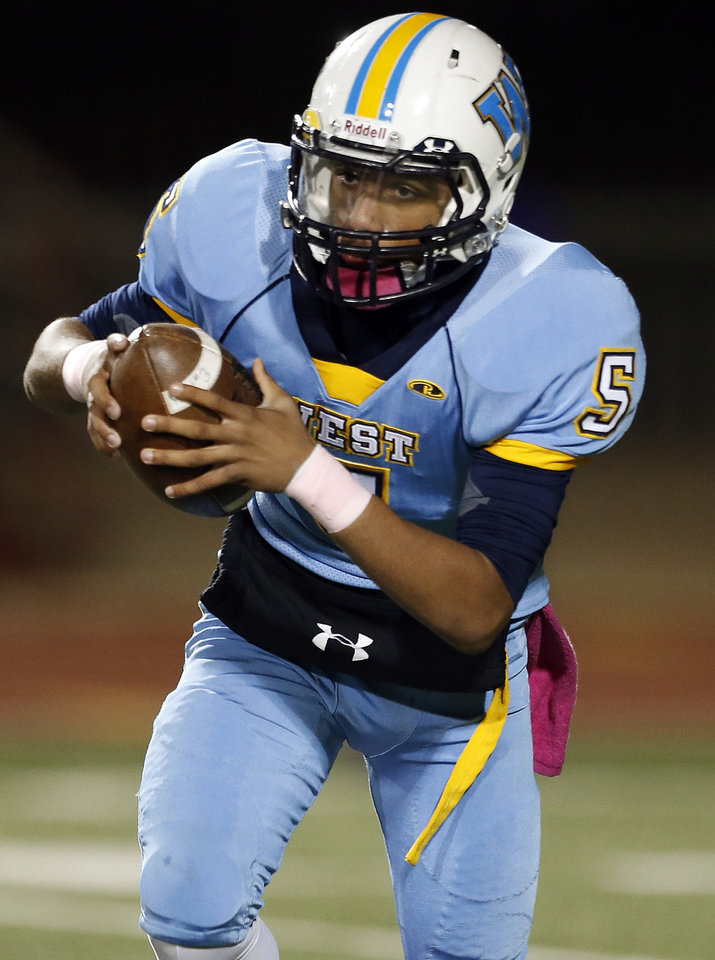 Photo - Putnam City West's Steven Stallings scrambles during the high school football game between Putnam City West and Norman at Putnam City High School, Thursday, Oct. 25, 2012. Photo by Sarah Phipps, The Oklahoman